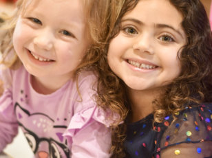 two female kids smiling