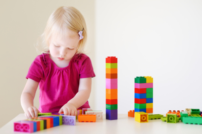 toddler playing plastic blocks
